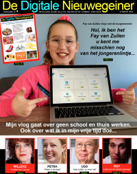 Fay achter de laptop in de digitale krant